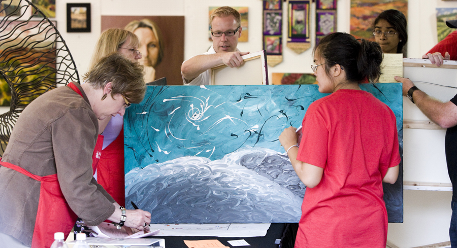 volunteers check in art at the Lake Oswego Festival of the Arts